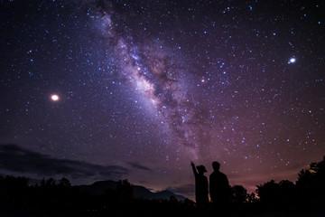 Aluminium Prints Eggplant Night sky stars with milky way on mountain background