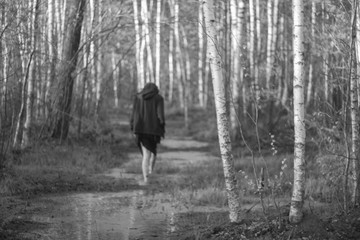 Girl walking through the swamp and the forest one