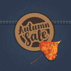 Vector banner with the words Autumn sale on a stitched round patch and autumn leaf on a denim background. Can be used for flyers, banners or posters