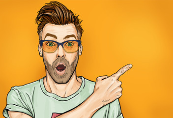 Amazed fashionable guy in glasses with open mouth, stares aside, shows something strange and unexpected. Emotions and advertisement. Surprised men.