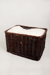 Brown wicker basket against white background