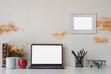 Workspace with modern desktop computer, office supplies flower plant at home or studio. Mock up.