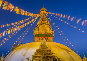 Swayambhunath temple at night in Kathmandu, Nepal.