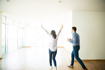 Excited Man And Woman Entering Into New Apartment