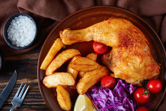 fried chicken leg, potato and salad, close-up