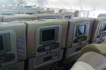 The interior of an empty aircraft, ready to fly cabin airliner with rows of seats.
