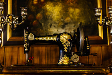 Granada, Spain - 2018. Vintage restaurant decorations. Old sewing machine on a wooden table.