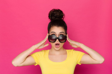 Surprised Young Woman In Sunglasses Is Holding Head In Hands