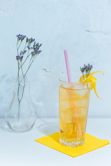 yellow cocktail and flower
