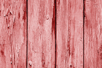 Old grunge wooden fence pattern in red tone.