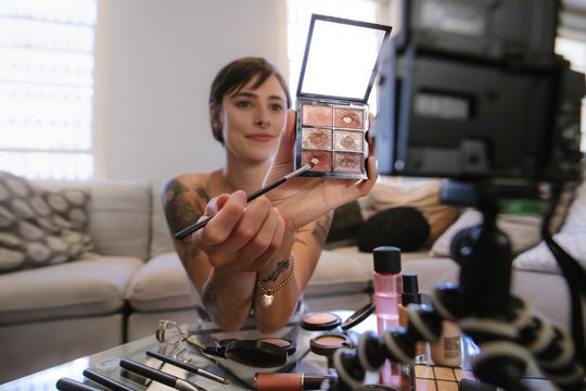 Beauty influencer recording content for online vlog