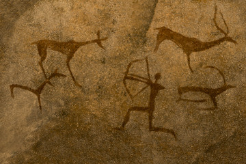 An image of ancient animals painted by an ancient man on a cave wall. history, archeology.