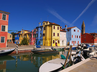 The romantic houses painted in brilliant pastel shades on the Island of Burano Italy