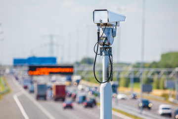 Surveillance camera in front of a Dutch highway
