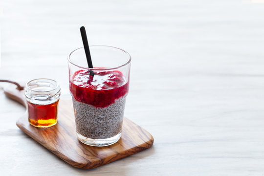 Chia pudding with red berry puree and marple syrup