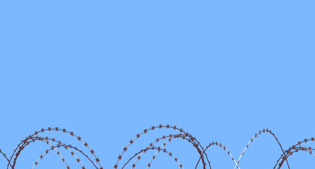 Razor wire against sky