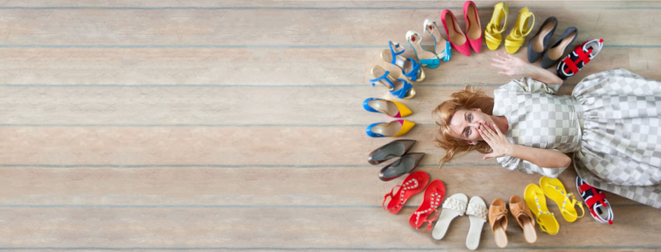 Woman choosing shoes. Colored shoes are exposed in a circle.