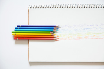 Color pencils on white background, copy space