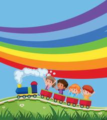 Train with children infront of rainbow