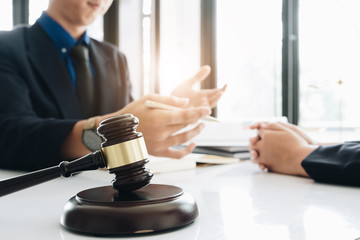 Business lawyer working about legal legislation in courtroom to help their customer, Selective Focus