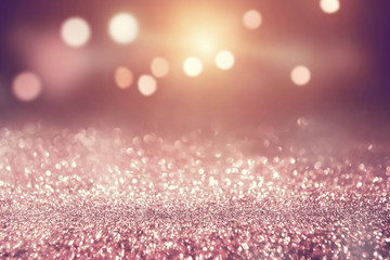 Rose gold glitter lights bokeh abstract background holiday.