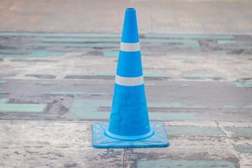Blue street cone on the street