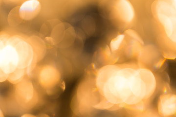 abstract background of golden bokeh from chandelier