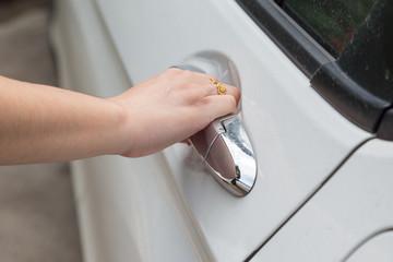 Woman hand open white car door