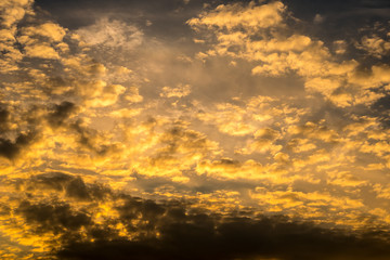 dark cloudy sky with strong orange clouds at late sundown