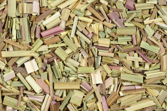 Chopped dried lemongrass isolated on white background