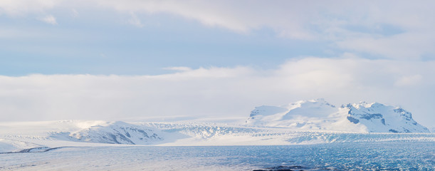 Glaciers and iceberg panorama in jokulsalon lagoon Iceland