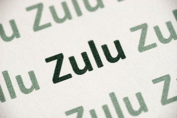 word Zulu language printed on paper macro