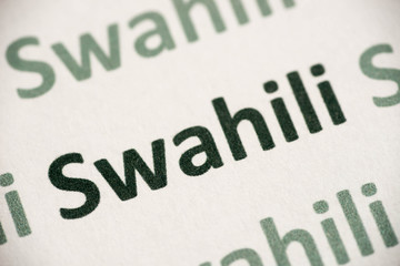 word Swahili language printed on paper macro