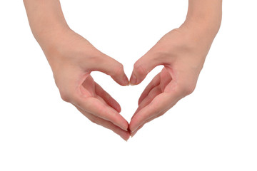 Close up of heart made by women hands with pale skin isolated on over white background