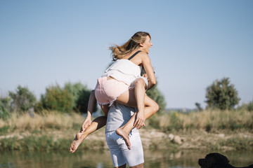 Man and woman have fun together the lake.