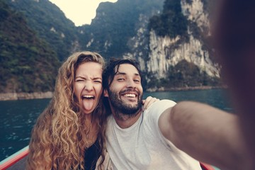 Couple taking selfie on a longtail boat Wall mural