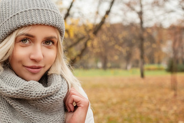 Young woman on autumn background. Outdoor portrait, female face closeup