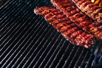 Grill Meat Food. Pork Ribs Grilling Closeup