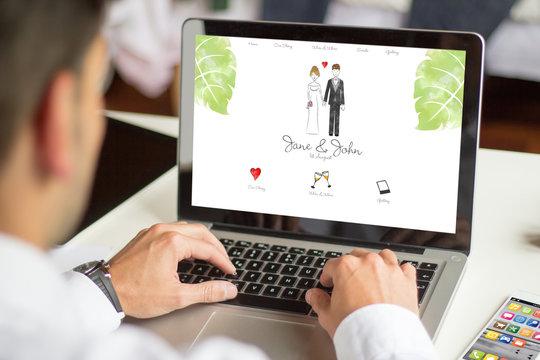 businessman browsing wedding website with computer