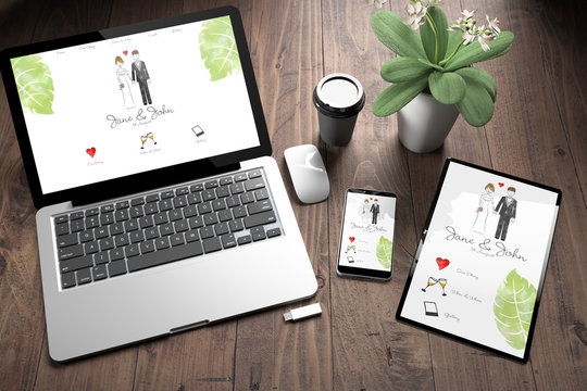 three devices on wooden desk top view wedding website