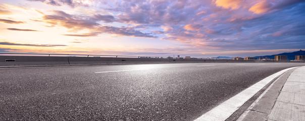 Fototapete - empty asphalt highway street with city skyline