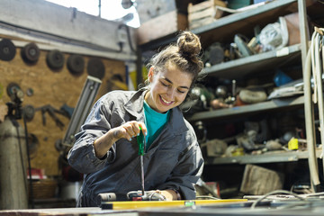 young woman working in a workshop