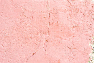 old pink wall in cracks
