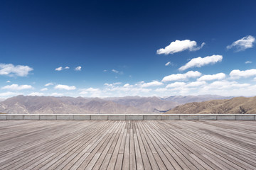 wooden floor with mountain and sky