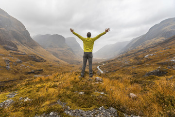 UK, Scotland, man in the Scottish highlands near Glencoe with a view on the Three Sisters