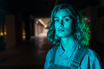 Portrait of a beautiful woman at night, wearing dungarees