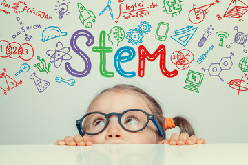 STEM word and symbols over beautiful cute little girl. modern education concept