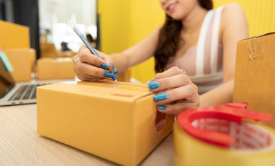 Asian woman hand is taking note on purchase orders.