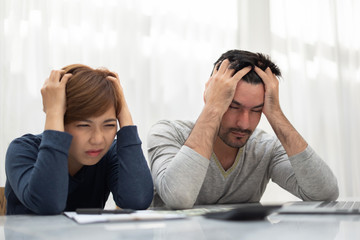 Young couple calculating their budget for new house.