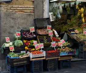 Colorful fruits and vegetables in a shop from an italian street. Selling prices indicated in euros